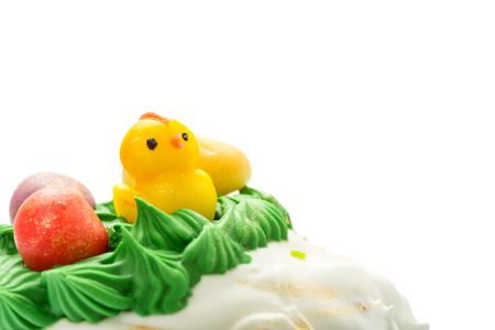 Top part of Easter cake with cream and funny chick.