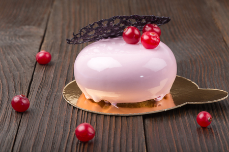 French mousse cake covered with pink glaze