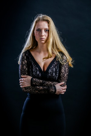 cocky: Beautiful Russian blonde girl on a black background in a dark guipure dress