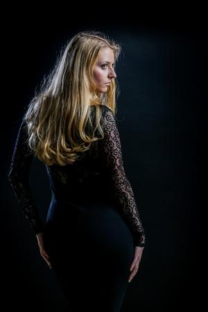 guipure: Beautiful Russian blonde girl on a black background in a dark guipure dress