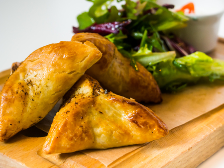 side salad: Chicken Pot-Pie dinner with fresh bread and side salad. Stock Photo