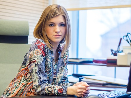 sits on a chair: Beautiful Russian girl sits in an office chair of her boss