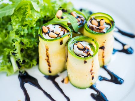 mascarpone: Zucchini rolls with creamy mascarpone cheese, nuts, green salad and soy sauce