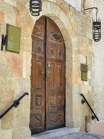 enhances: Yellow stone enhances the brown finish of the door