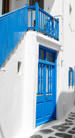 white washed: White washed walls frame a blue door and staircase