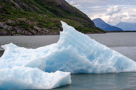 calved: A calved iceberg from Portage Glacier is seen against the Chugach Mountains
