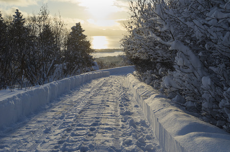 cloud drift: A freshly cleared driveway shows deep snow in a bright Alaskan winter morning Stock Photo