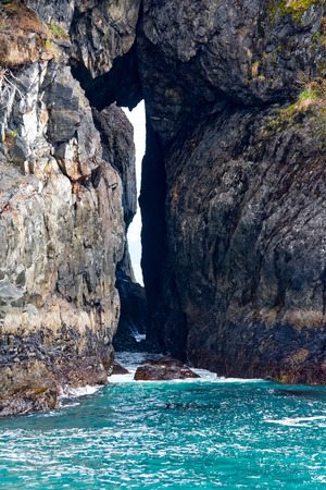 Water rushes into arch formed from solid rock
