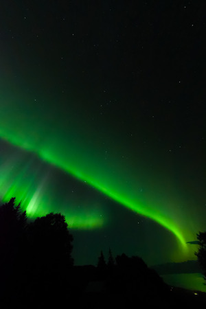 ionosphere: A double band of green light up Kachemak Bay in south central Alaska.
