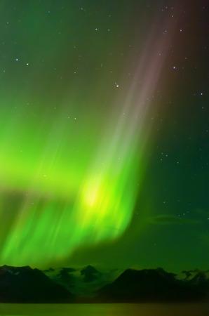 inlet bay: An aurora drfits over Grewingk Glacker in the Kenai Mountains, Alaska.
