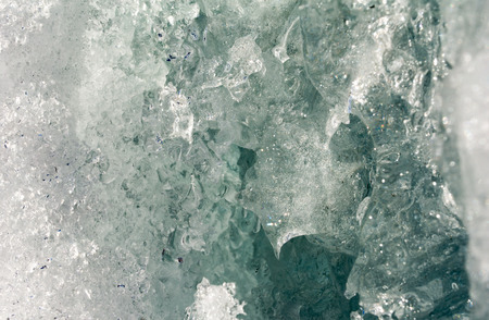 Melting ice as formed a channel into the dark depths. Imagens