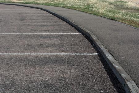 parking spaces: White lines form parking spaces on black asphalt. Stock Photo