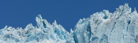 ridgeline: Blue white ice reaches towards the sky as the glacier pushes forward.