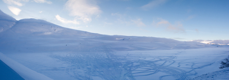 shadowed: Snow machines created a myriad of tracks in a shadowed snow covered bowl.