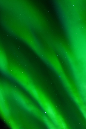 ionosphere: Bands of green aurora fill the entire sky.