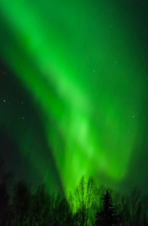 icecream cone: An aurora swirls up from the horizon like an icecream cone.
