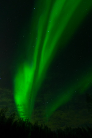wisps: A bright aurora almost overwhelms a second rushing up behind.