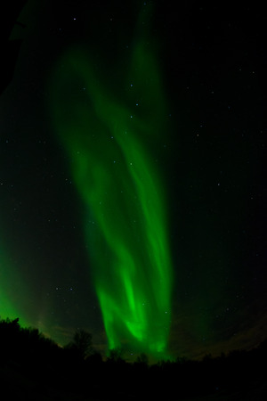 ionosphere: An aurora twists into s curves on its way across the sky. Stock Photo