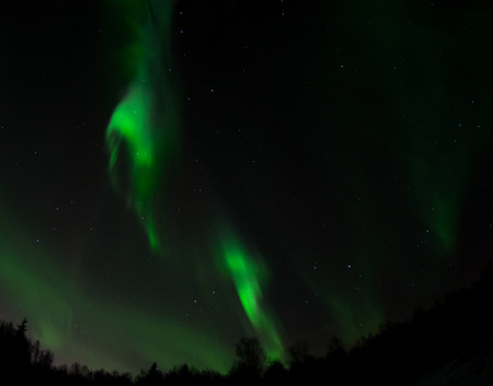 ionosphere: As an aurora fades only patches of green light fill the night sky. Stock Photo