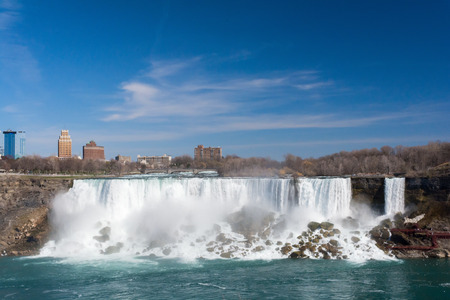 american falls: The American Falls, the lesser of the two Niagara Falls, still sends tons of water over a tall drop.