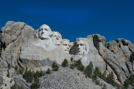 mount rushmore: Mount Rushmore set against a bright cloud free blue sky.