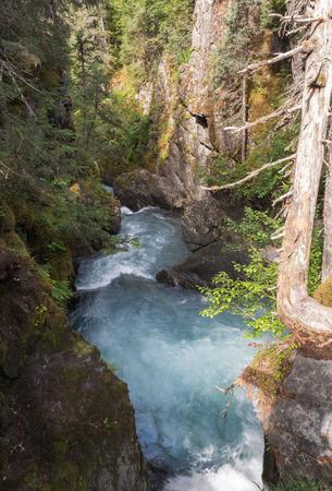 GIRDWOOD, ALASKA, - JULY 26 - Water rushes through a gap in the rocks near the Winner trail.