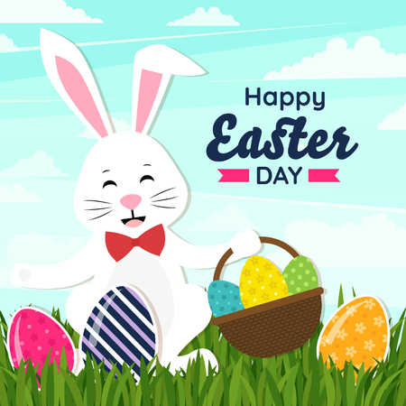 Happy easter day. White Easter bunny with a basket full of decorated Easter eggs in a field