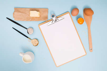 Flour and kitchen utensils whisk, baking dish, rolling pin with eggs on the table. Baking, cooking concept, top view with place for text. Stok Fotoğraf