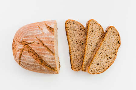 Different baking buns, croissants, gingerbread cookies. Delicious freshly baked bread on wooden background with place for text. Fresh loaves of bread And sliced breads containing sesame seeds. Stok Fotoğraf