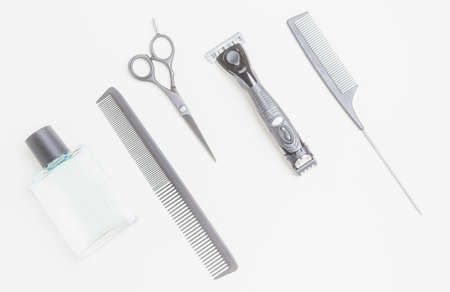 Various tools for the care of a beard and hairstyle. Scissors, razors, combs. Shaving concept. Barbershop. Imagens