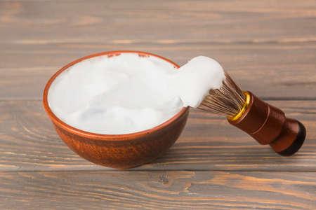 Shaving tools: brush, foam, shaver.