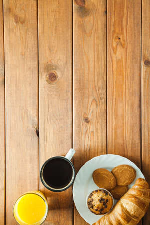 Healthy breakfast  muesli with blueberry and honey, yogurt, growing, juice and coffee.