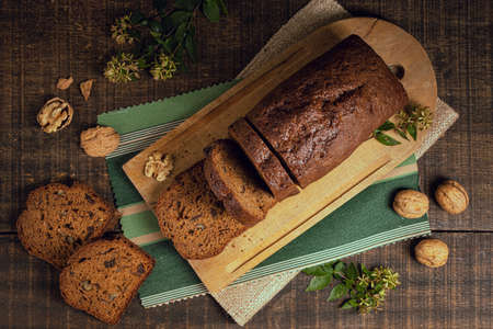 Delicious freshly baked bread on wooden background with place for text. Fresh loaves of bread And sliced breads