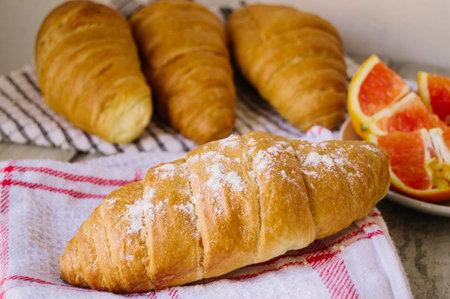 Healthy breakfast orange, grapefruit, growing, and coffee. Bakery