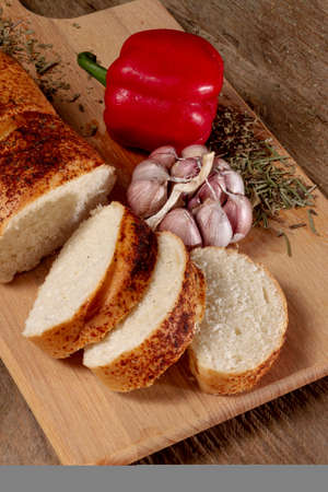 Different baking buns, croissants, gingerbread cookies. Delicious freshly baked bread on wooden background with place for text. Fresh loaves of bread And sliced breads containing sesame seeds.