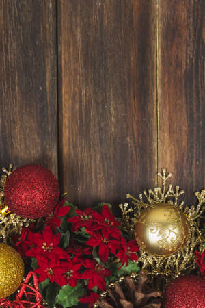 A vase of flowers sitting on top of a wooden table. Wooden christmas background. High quality photo
