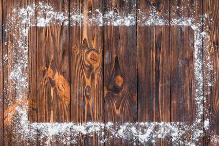 white flour edge rectangular frame wooden table Stock Photo