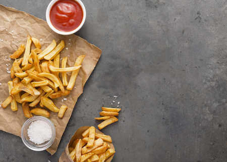 top view french fries paper with salt copy space. Resolution and high quality beautiful photo