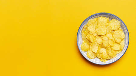 top view chips bowl yellow background. Resolution and high quality beautiful photo Reklamní fotografie