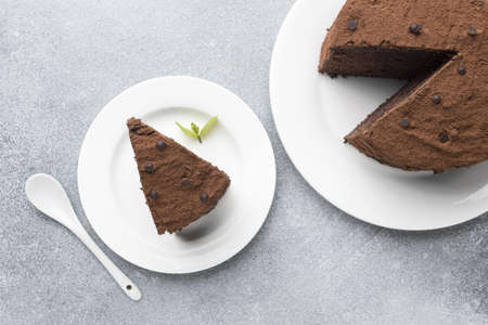 top view chocolate cake slice with spoon mint. Resolution and high quality beautiful photo