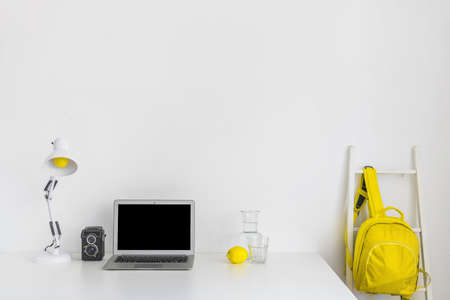 stylish workplace white yellow colors with backpack laptop. Resolution and high quality beautiful photo Reklamní fotografie - 166064979