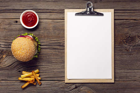 top view burger with mock up clipboard. Resolution and high quality beautiful photo