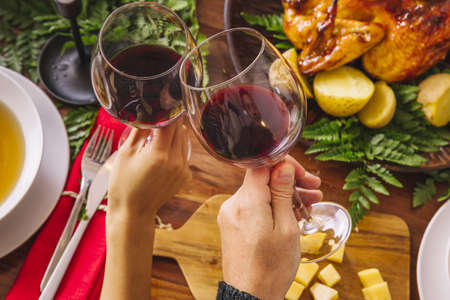 toasting with two glasses wine. Resolution and high quality beautiful photo Reklamní fotografie - 166065309