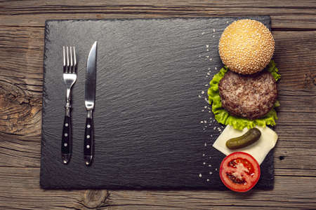 top view burger ingredients slate board. Resolution and high quality beautiful photo Reklamní fotografie
