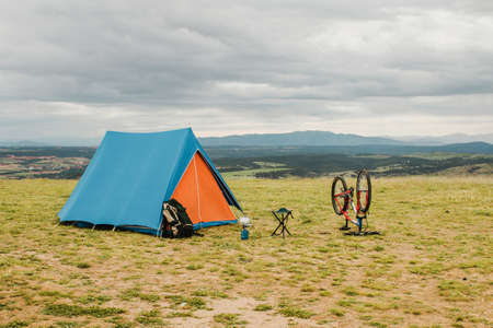 tent bike countryside. Resolution and high quality beautiful photo Reklamní fotografie - 166065330