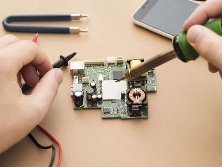 man using soldering iron circuit (1). Resolution and high quality beautiful photo