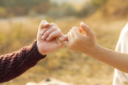man woman making pinky promise (1). Resolution and high quality beautiful photo