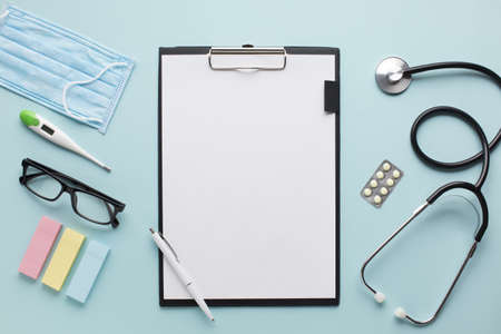 overhead view healthcare accessories near clipboard with plank paper spectacles background. Resolution and high quality beautiful photo Reklamní fotografie