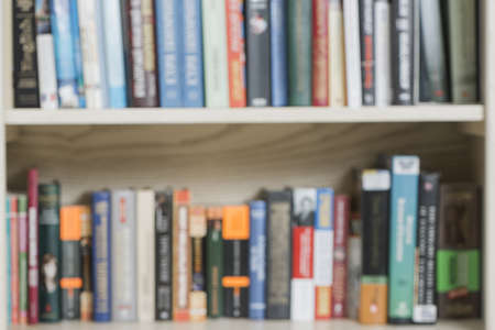 blurred volumes bookshelf. Resolution and high quality beautiful photo