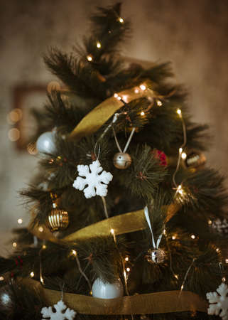 christmas tree decorated with golden white ornaments. Resolution and high quality beautiful photo